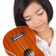 A young Asian girl holding a ukulele — Stock Photo