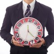 Businessman holding a clock in his hands — Stock Photo