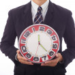 Foto de Stock  : Businessmholding clock in his hands