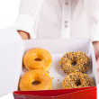 Woman offers donuts — Stock Photo