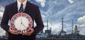 Businessman holding a clock — Stock Photo