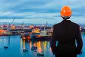 Businessman standing at its own port — Stock Photo