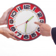 Two businessmen are holding clock — Stockfoto #33680375