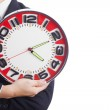 Businessman holding a big red clock — Stock Photo #33680815