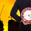 Businessman holding a big red clock — Stock Photo #33680885