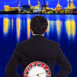 Businessman holding a big red clock — Stock Photo
