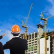 Two engineers on construction background — Foto Stock