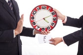 Two businessmen are holding clock — Stock Photo