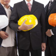 Construction engineers with helmets — Stock Photo