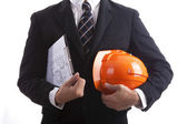 Construction engineer with a red helmet and documents in hand — Stock Photo