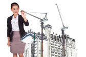 Asian woman engineer draws a crane on the construction — Stock Photo