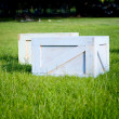 Wooden crates in garden on green grass — Stockfoto
