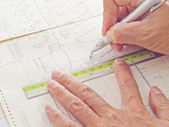 Pen and ruler on hand examining scientific graph to analysis the — Stock Photo