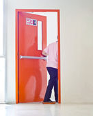 Man is opening the emergency door. — Stock Photo