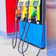 Colorful oil pump nozzles on the petrol station — Stock Photo