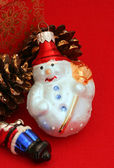 Snowman Christmas Ornament on Red — Photo