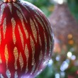 Stock Photo: Large Red Glitter Christmas Ball on Tree