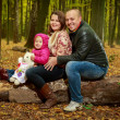 Family in the autumn forest — Stock Photo