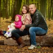 Stock Photo: Family in the autumn forest