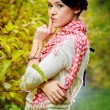 The beautiful girl in the autumn forest — Stockfoto