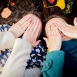 Girls in the autumn park covering face with hands — Stock Photo