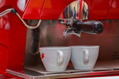 Two cups on red coffee machine — Foto de Stock