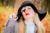 Pretty girl in black hat — Stock Photo