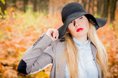 Young girl in black hat — Stock Photo