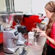 Waitress making cappuccino at coffee machine — Photo