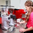 Waitress making cappuccino at coffee machine — Stockfoto