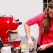 Girl making cappuccino — Stock Photo