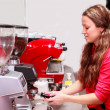 Waitress making cappuccino at coffee machine — ストック写真