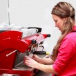 Waitress making cappuccino at coffee machine — Stock Photo #34587221