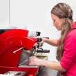 Waitress making cappuccino at coffee machine — Stok fotoğraf