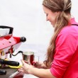 Waitress making cappuccino at coffee machine — Stock Photo