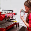 Waitress pouring milk making cappuccino — Stock Photo