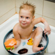 Stock Photo: Little boy is bathed in tub