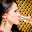 Stock Photo: Girl in pink dress drinking champagne