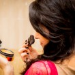Woman doing makeup — Stock Photo
