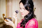 Woman doing makeup — Stock Photo
