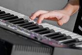 Man playing the synthesizer keyboard — Stock Photo