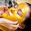 Stock Photo: Gold facial mask