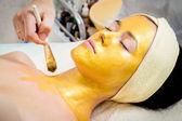Gold facial mask — Stock Photo