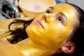 Gold facial mask — Stock Photo