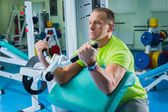 Sportsman in gym — Stock Photo