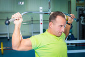 Sportsman in gym — Stock Photo