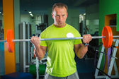 Sportsman with barbell — Stock Photo