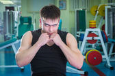 Sporty man in gym — Stock Photo
