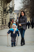 Mother and her son walking in city — Stock Photo