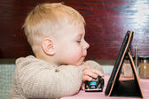 Boy looking at tablet computer — Foto Stock